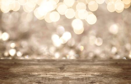 Holiday glitter light background with firework and wood copy space