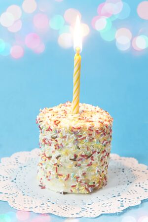 Birthday cake with a burning candle 写真素材
