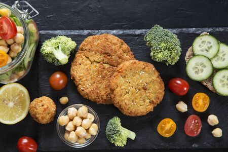 Vegetarian burgers with humus and the fresh vegetables