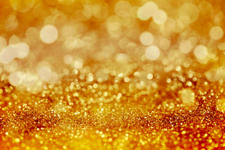 Yellow glitter abstract light background