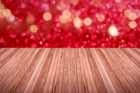 Holiday glitter light background with wood copy space