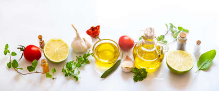 Herbs, spices and olive oil on white background