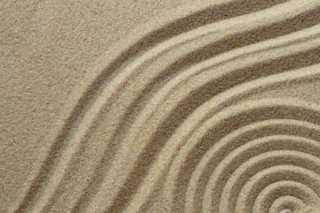 Zen pattern in brown sand Stock Photo