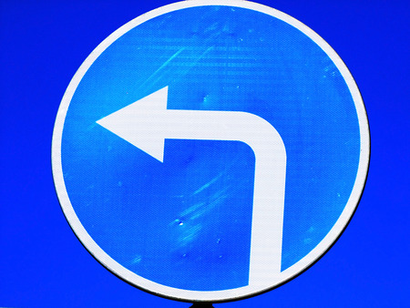 changing form: Road sign: turn to the left Stock Photo