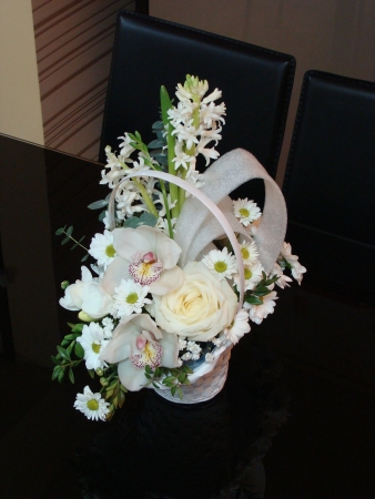 Flower arrangement with white flowers in a basket photo