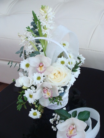 Easter basket with white spring flowers photo