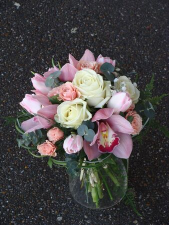 roses in vase: Bride bouquet with orchids and spring flowers