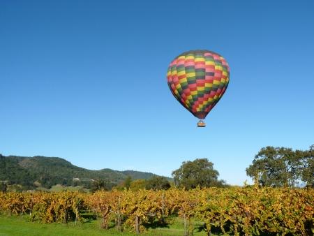 Hot Air Balloon floating over Napa Valley Vineyard