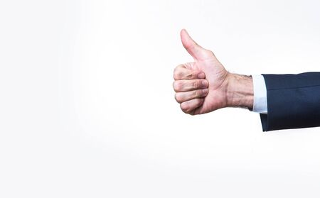 Senior business mans hand giving a thumb up, isolated on white