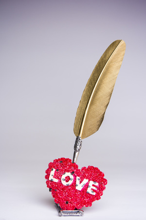Love letter for valentine, romantic setup with an envelope with sweet words for a loved one, white background