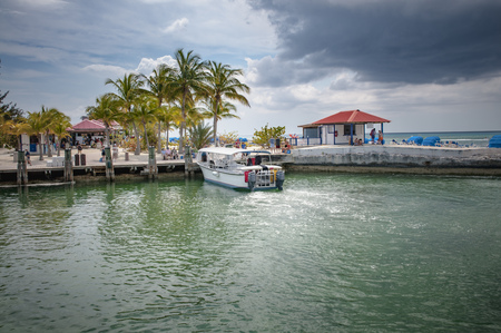 PRINCESS CAYS, FEBRUARY 2015 - Tender boat from a cruise ship docking in the port of Princess Cays island, disembarking passengers and tourists. Editorial