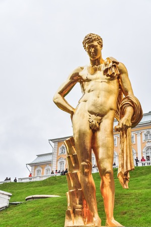 MAY 2015, PETERHOF PALACE - SAINT PETERSBURG, RUSSIA: Peterhof Palace, famous monumental building with water streams and large golden statues around it Editorial