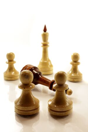 a few chess figures on the white bckground Stock Photo - 9777693
