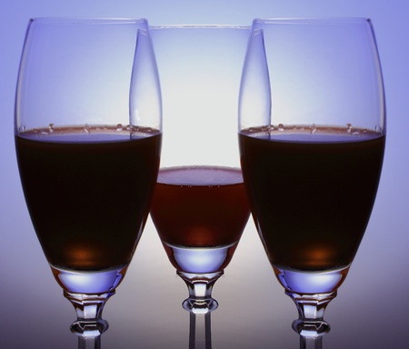three glasses on the colored background photo