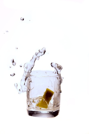 cutglass: a splash of water and a lemon Stock Photo
