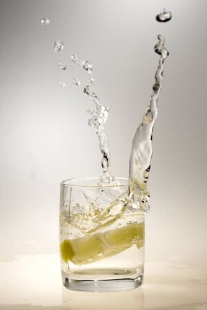 a glass of water and a lemon photo