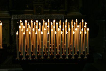 prayer candles in church soft glow Banco de Imagens