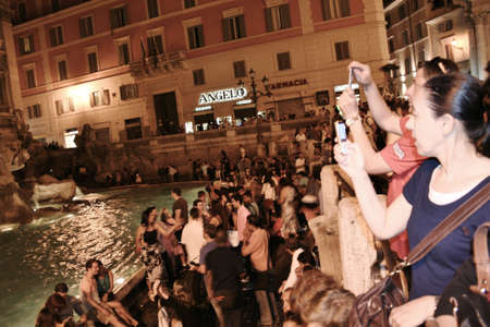 Trevi Fountain Rome at night with tourists Editöryel