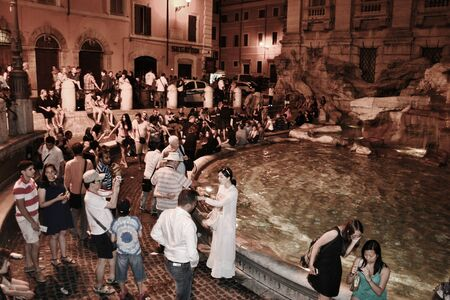 Trevi Fountain Rome at night with tourists Banco de Imagens