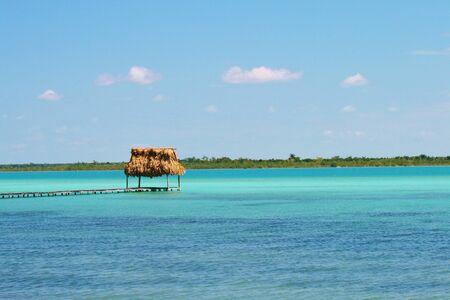 Beautiful green sea and thatched pier near Tulum Banco de Imagens