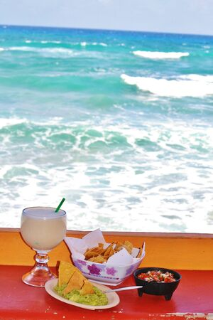 chips and salsa: Fresh chips, salsa and pina colada, Cozumel Mexico Stock Photo