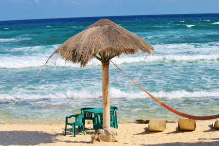 hut and hammock by beach in Mexico