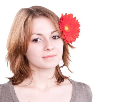 Beautiful young woman with gerber flower isolated on white background Stock Photo - 4471877