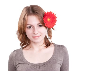 Beautiful young woman with gerber flower isolated on white background Stock Photo - 4471880