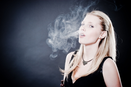 Woman smoking over black photo
