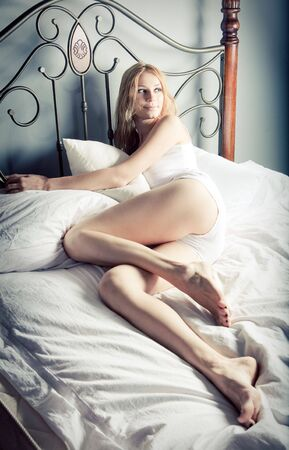 Beautiful lady relaxing in the bedroom photo