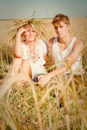 Image of happy young man and woman  on wheat field Stock Photo - 6128798