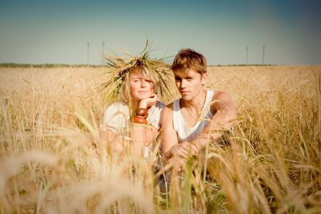 Image of happy young man and woman  on wheat field Stock Photo - 6151120