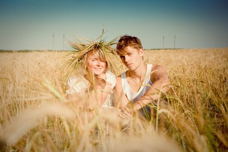Image of happy young man and woman  on wheat field Stock Photo - 6155592