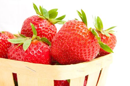 Fresh strawberries in basket isolated on white photo