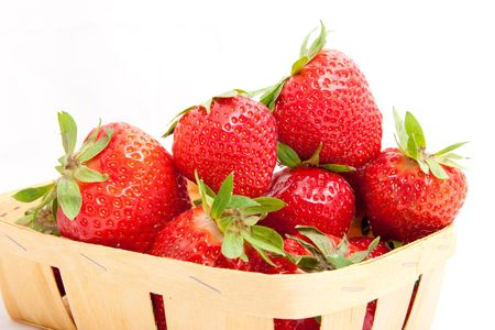 Fresh strawberries in basket isolated on white Stock Photo - 6171485