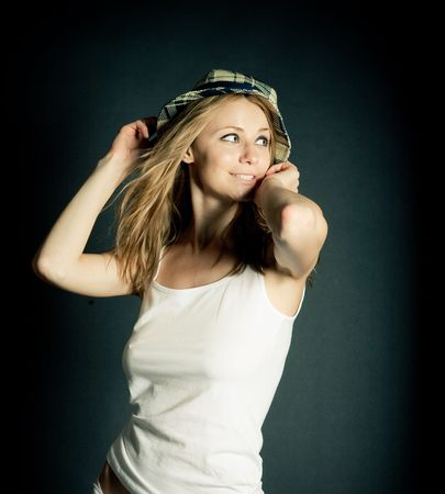 Beautiful Young Female Model in Studio with hat photo