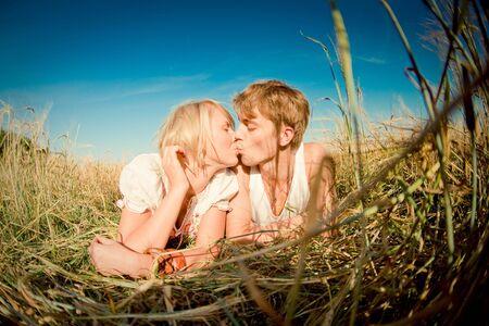 幸せな若い男と麦畑のなかに女性のイメージ 写真素材
