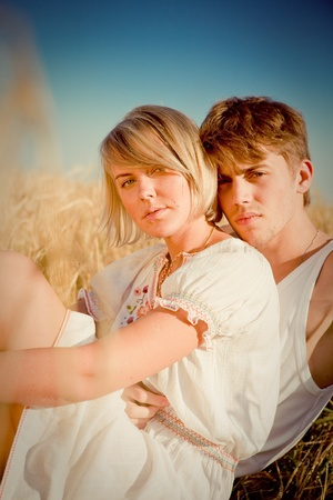 Image of young man and woman on wheat field Stock Photo - 8613348