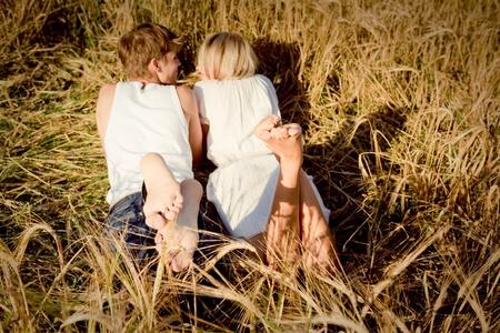 麦畑で若い男女のイメージ 写真素材