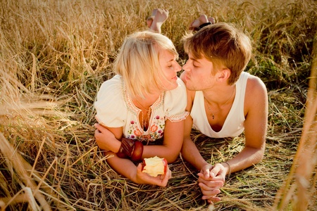 Image of young man and woman on wheat field Stock Photo - 8813044