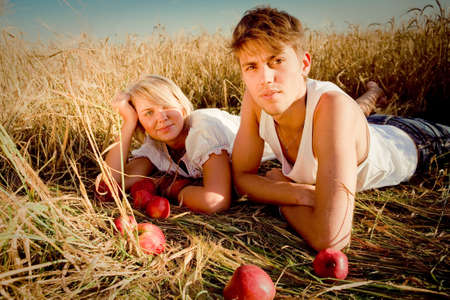 Image of young man and woman on wheat field photo