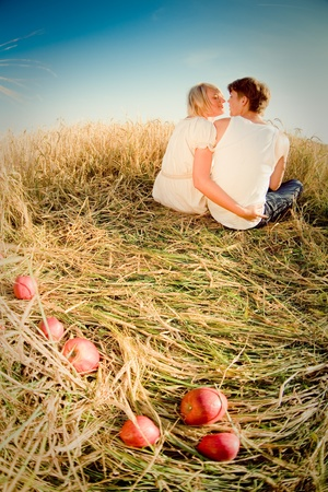Image of young man and woman on wheat field