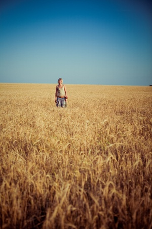 Image of young woman on wheat field Stock Photo - 9135636
