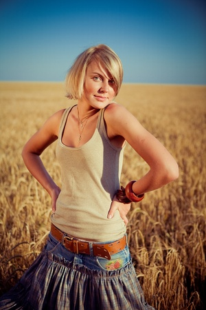 Image of young woman on wheat field Stock Photo - 9135640
