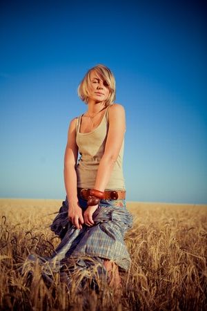Image of young woman on wheat field Stock Photo - 9154364