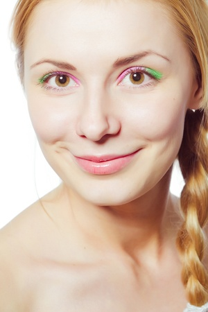 Close-up portrait of beautiful girl with bright makeup  photo