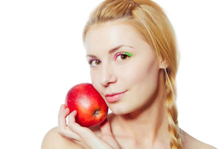 specialization: portrait of  young woman with red apple isolated on white