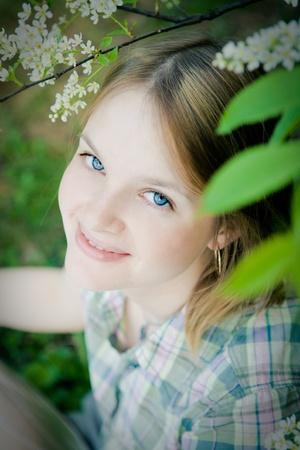 beautiful  girl in spring garden  photo
