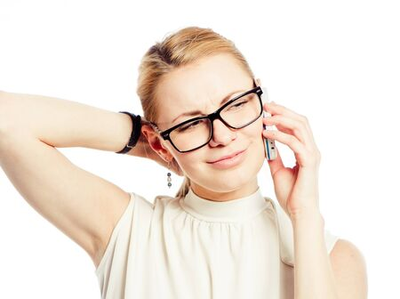freaking: Stressed and freaking out woman talking on the phone Stock Photo