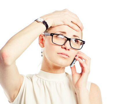 Stressed and freaking out woman talking on the phone Stock Photo - 10078899